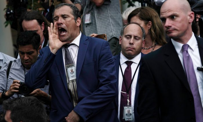 Brian Karem, a Playboy reporter, shouts at former aide to President Donald Trump, Sebastian Gorka, in the Rose Garden at the White House on July 11, 2019. (Photo by Alex Wong/Getty Images)