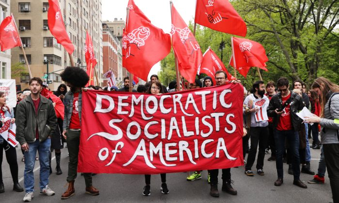 Members of the Democratic Socialists of America gather outside of a Trump owned building on May Day in New York on May 01, 2019. (Spencer Platt/Getty Images)