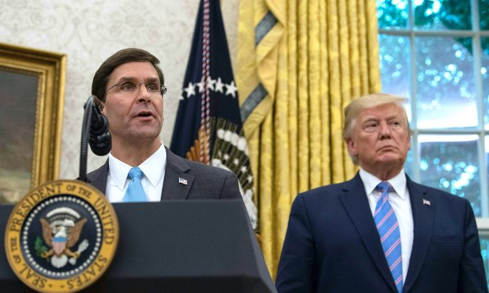 Defense Secretary Mark Esper speaks after he was sworn in as President Donald Trump looks on in the Oval Office at the White House in Washington, DC, on July 23, 2019. (Nicholas Kamm/AFP/Getty Images)
