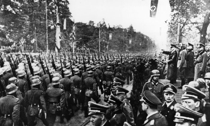 German troops parade in front of Adolf Hitler and Nazi Generals after entry into Warsaw on Oct. 5, 1939.  (Keystone/Getty Images)