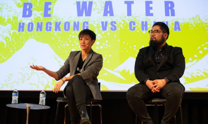 """Cantopop star turned political activist Denise Ho Wan-see, also known as HOCC (left), and Chinese political cartoonist Badiucao, during the """"Be Water: Hong Kong v China"""" event at Melbourne City conference centre  in Melbourne, Australia on Sept. 4, 2019. The event was held to discuss the current crisis in Hong Kong and the future of the city. (Asanka Ratnayake/Getty Images)"""