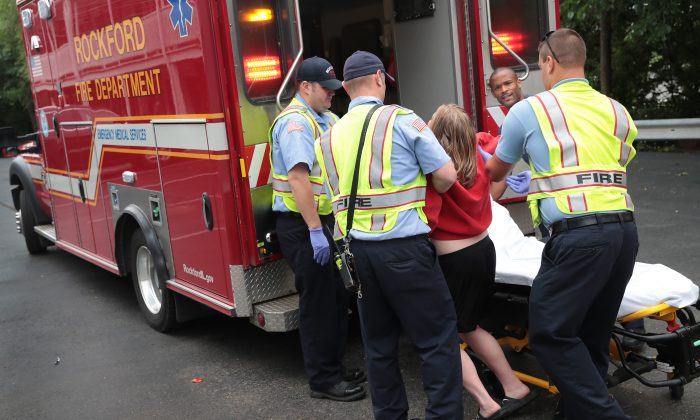 Firefighters help an overdose victim in Rockford, Illinois, on July 14, 2017. (Scott Olson/Getty Images)