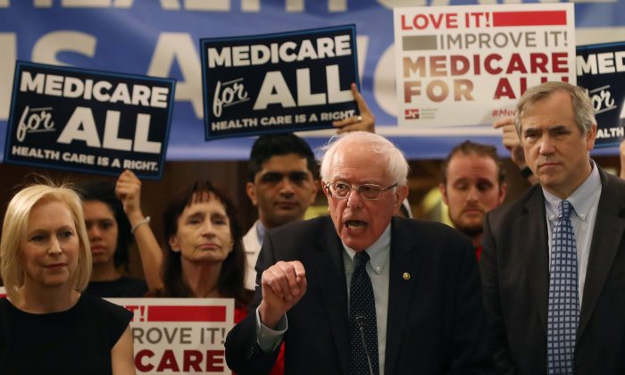 """Sen. Bernie Sanders (I-VT) speaks while introducing health care legislation titled the """"Medicare for All Act of 2019"""" with Sen. Kirsten Gillibrand (D-NY) and Sen. Jeff Merkley (D-OR), during a news conference on Capitol Hill in Washington, DC. on April 9, 2019. (Mark Wilson/Getty Images)"""