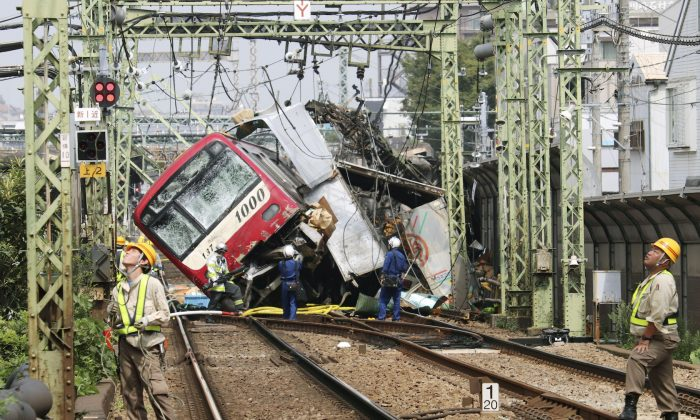A train is seen as it is derailed after a collision with a truck in Yokohama, near Tokyo, Japan on Sept. 5, 2019. (Kyodo/via Reuters)