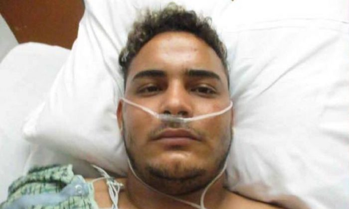Javier Medina-Tamayo in the hospital after being shot. (Palm Beach County Sheriff's Office)