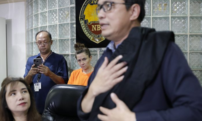 American Jennifer Erin Talbot from Ohio listens during a press conference by the National Bureau of Investigation in Manila, Philippines on Sept. 5, 2019. (AP Photo/Aaron Favila)