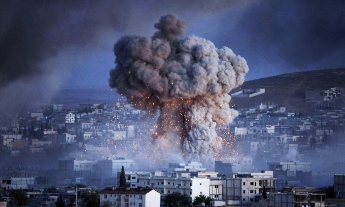 File photo showing an explosion in the Syrian city of Kobani during a reported suicide car bomb attack by the ISIS terrorists on Oct. 20, 2014. (Gokhan Sahin/Getty Images)