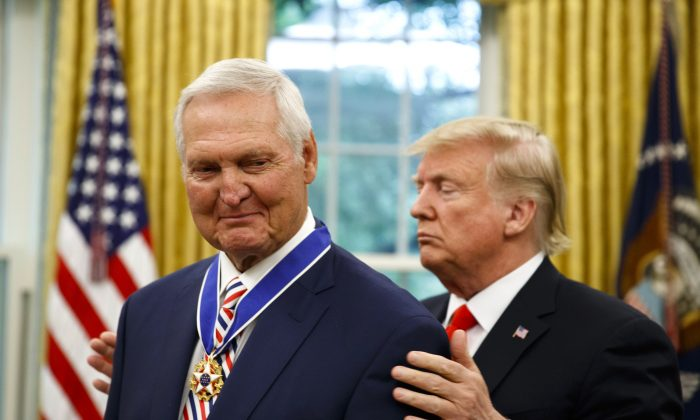 President Donald Trump (R) presents the Presidential Medal of Freedom to former NBA basketball player and general manager Jerry West, in the Oval Office of the White House on Sept. 5, 2019. (Alex Brandon/AP Photo)