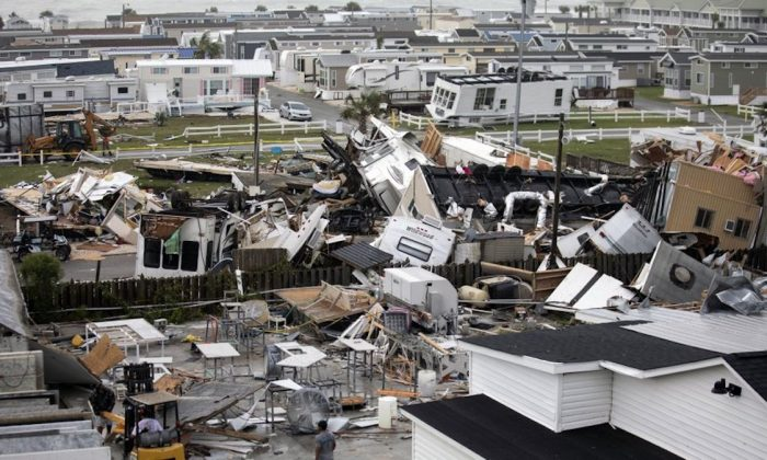 Mobile homes are upended and debris is strewn about at the Holiday Trav-l Park, in Emerald Isle, N.C, after a possible tornado generated by Hurricane Dorian struck the area on Sept. 5, 2019. (Julia Wall/The News & Observer via AP)
