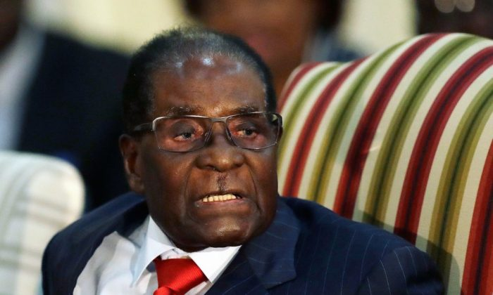 In this Oct. 3, 2017 file photo, then Zimbabwean President Robert Mugabe speaks during a meeting with South African President Jacob Zuma at the Presidential Guesthouse in Pretoria, South Africa. (AP Photo/Themba Hadebe, FILE)