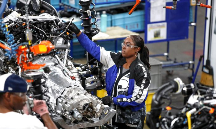 Workers build the 2020 Ford Explorer at Ford's Chicago Assembly Plant in Chicago, Ill., on June 24, 2019. (Kamil Krzaczynski/Reuters)