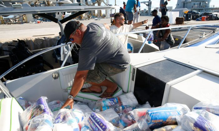 Aid and supplies arrive via private boat from Spanish Wells of Eleuthera Island in Great Abaco Island, Bahamas, on Sept. 6, 2019. (Jose Jimenez/Getty Images)