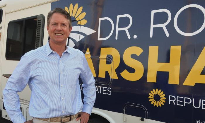 U.S. Rep. Roger Marshall (R-Kan.), stands outside an RV he uses in traveling across the state to events in Topeka, Kansas, on Sept. 5, 2019. (John Hanna/AP Photo)