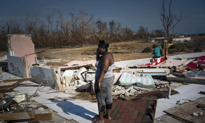 A woman is overcome as she looks at her house destroyed by Hurricane Dorian, in High Rock, Grand Bahama, Bahamas, on Sept. 6, 2019. (Ramon Espinosa/AP Photo)