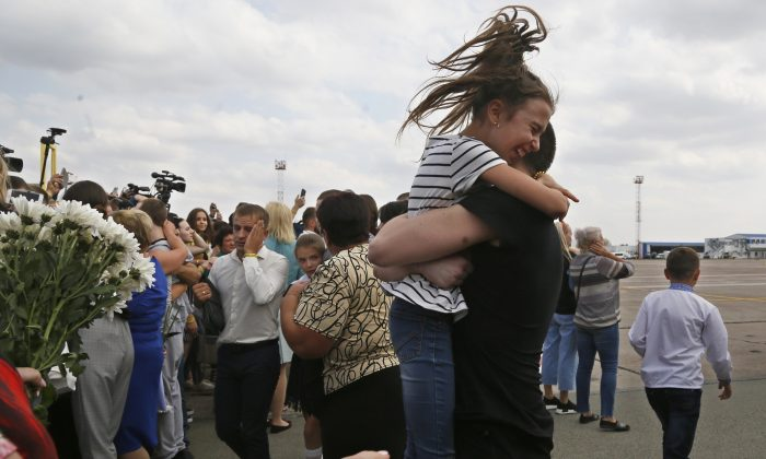 Relatives of Ukrainian prisoners freed by Russia greet them upon their arrival at Boryspil airport, outside Kyiv, Ukraine on Sept. 7, 2019. (AP Photo/Efrem Lukatsky)