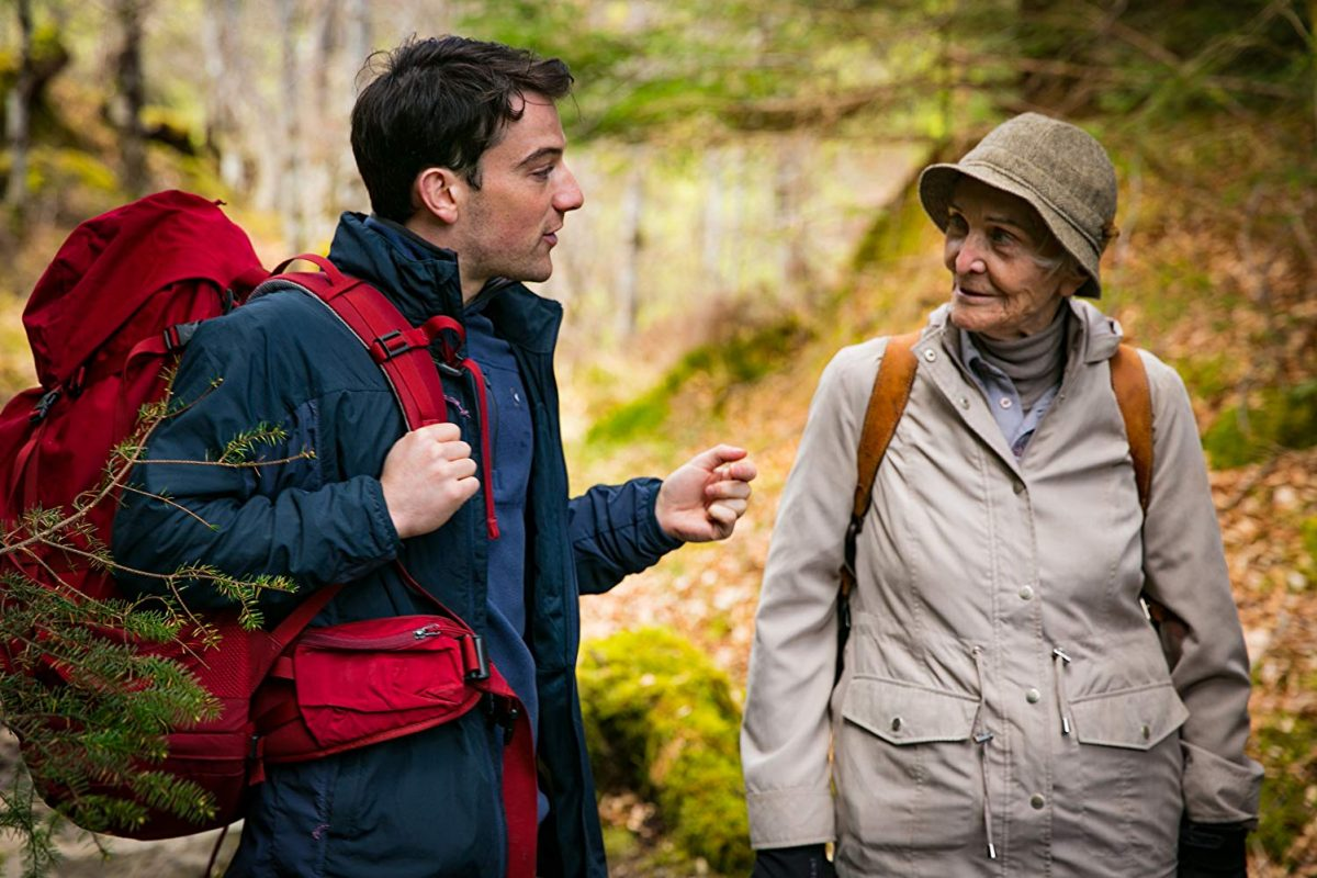 young man and old woman training for hiking_
