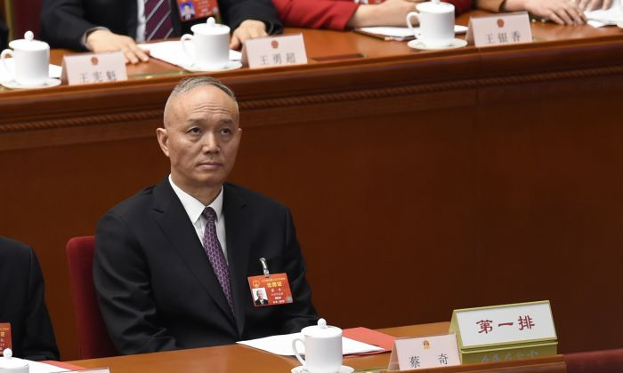 Cai Qi, a member of the Political Bureau of the Communist Party of China (CCP) Central Committee and secretary of the CCP Beijing Municipal Committee, attends the closing session of the National People's Congress in Beijing's Great Hall of the People on March 15, 2019. (WANG ZHAO/AFP/Getty Images)