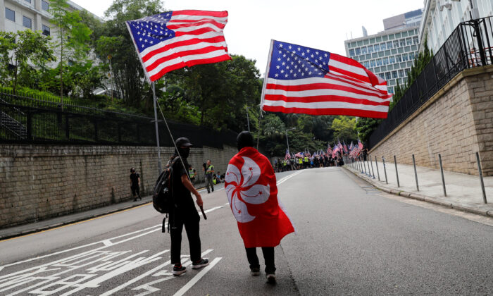 Protesters hold U.S. flags during a march to the U.S. Consulate General in Hong Kong on Sept. 8, 2019. (Anushree Fadnavis/Reuters)