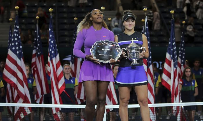 Serena Williams, of the United States, left, and Bianca Andreescu, of Canada, pose for photos after Andreescu won the women's singles final of the U.S. Open tennis championships Saturday, Sept. 7, 2019, in New York. (AP Photo/Charles Krupa)