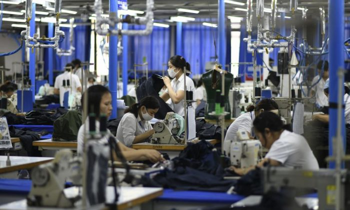 Garment factory workers make men's suits in a factory in Hanoi, Vietnam, on May 24, 2019. (Manan Vatsyayana/AFP/Getty Images)