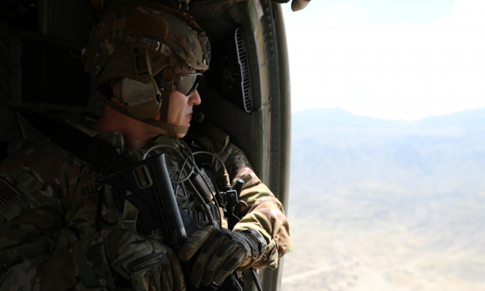 An advisor from the 2nd Security Force Assistance Brigade flies during their deployment to Afghanistan April 12, 2019.  (Courtesy Sgt. Jordan Trent/U.S. Army/Handout via Reuters)