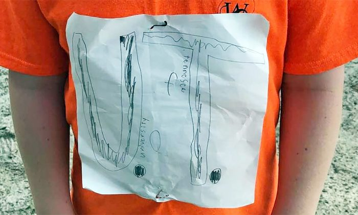 An Altamonte Elementary School student shows his home made t-shirt label in Altamonte Springs, Fla., on Sept. 5, 2019. (Courtesy of Laura Snyder/Facebook)