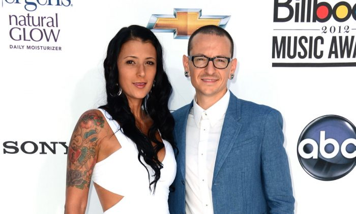 Musician Chester Bennington of Linkin Park (R) and wife Talinda Ann Bentley (L) arrive at the 2012 Billboard Music Awards held at the MGM Grand Garden Arena in Las Vegas, Nevada, on May 20, 2012. (Frazer Harrison/Getty Images for ABC)