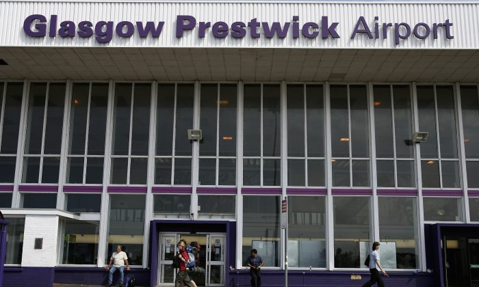 People walk past the enterance to Prestwick Airport in a file photograph. (Jeff J. Mitchell/Getty Images)