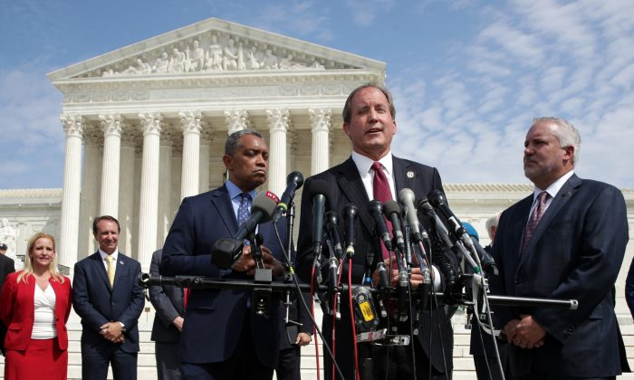 Texas Attorney General Ken Paxton speaks as Washington Attorney General Karl Racine (L) listens during a news conference in front of the U.S. Supreme Court in Washington on Sept. 9, 2019. (Alex Wong/Getty Images)