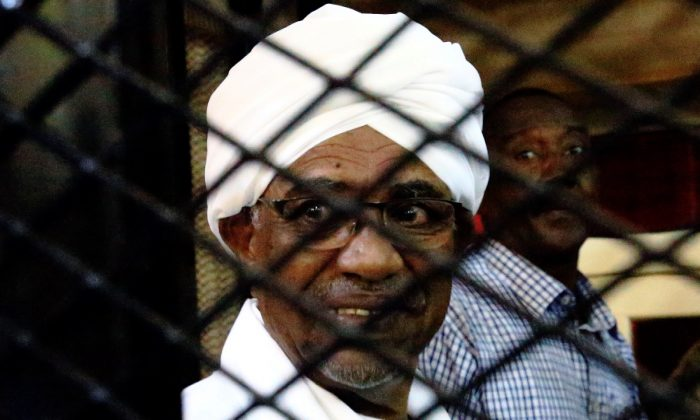 Sudan's former president Omar Hassan al-Bashir smiles as he is seen inside a cage at the courthouse where he is facing corruption charges, in Khartoum, Sudan, on Aug. 31, 2019. (Mohamed Nureldin Abdallah/Reuters)