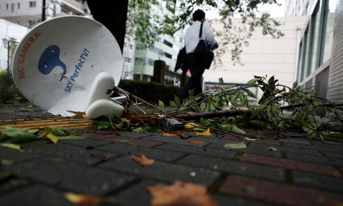 A satellite broadcast television receiving antenna, which was blown away by strong winds caused by Typhoon Faxai, is seen on a street in Tokyo, Japan, on Sept. 9, 2019. (REUTERS/Issei Kato)
