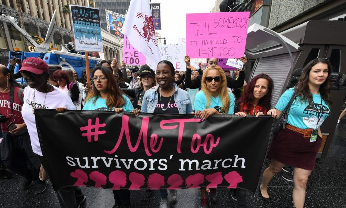 Women who are survivors of sexual harassment, sexual assault, sexual abuse and their supporters protest during a #MeToo march in Hollywood, Calif. on Nov. 12, 2017. (Mark Ralston/AFP/Getty Images)