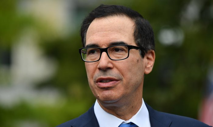 Treasury Secretary Steven Mnuchin answers  questions from journalists outside the White House on Sept. 9, 2019. (Nicholas Kamm/AFP/Getty Images)