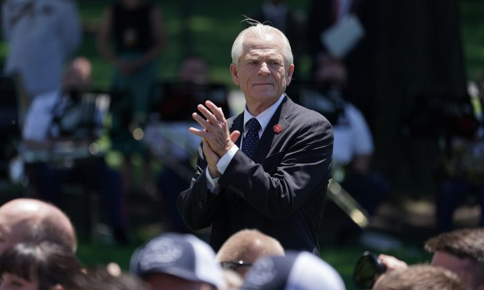 White House Trade and Manufacturing Policy Director Peter Navarro applauds for U.S. President Donald Trump during the 'Made In America' product showcase at the White House in Washington, on July 15, 2019. (Chip Somodevilla/Getty Images)