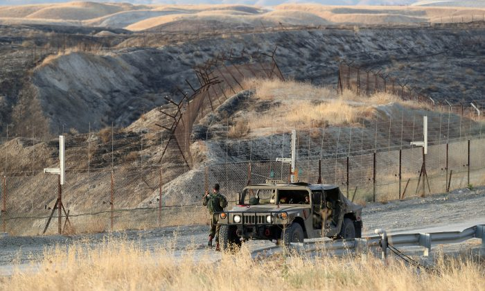 Israeli soldiers keep guard in Jordan Valley, the eastern-most part of the Israeli-occupied West Bank that borders Jordan on June 26, 2019. (Ammar Awad/Reuters)