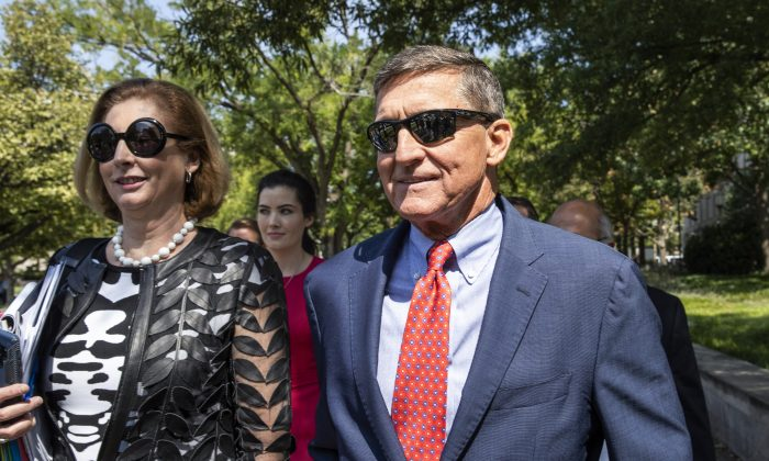 Michael Flynn, President Donald Trump's former national security adviser, leaves the federal court with his lawyer Sidney Powell following a status conference with Judge Emmet Sullivan in Washington on Sept. 10, 2019. (Manuel Balce Ceneta/AP Photo)