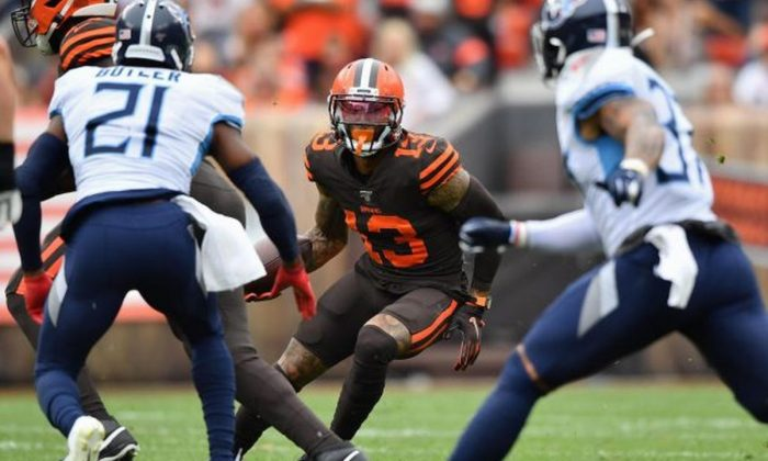 Odell Beckham Jr., #13, of the Cleveland Browns looks for running room after catching a pass in the second quarter against the Tennessee Titans at FirstEnergy Stadium in Cleveland, Ohio, on Sept. 8, 2019. (Jamie Sabau/Getty Images)