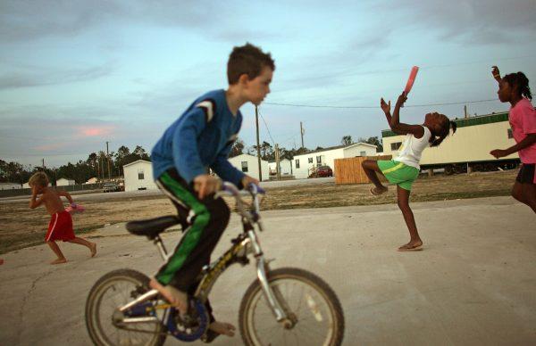Children play in the FEMA trailer park