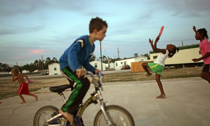 WAVELAND, MS - MAY 27:  Children play in the FEMA trailer park where they live after their homes were destroyed by Hurricane Katrina May 27, 2006 in Waveland, Mississippi. The Gulf Coast has been slow to recover from the storm and the next hurricane season begins June 1st.  (Photo by Mario Tama/Getty Images)