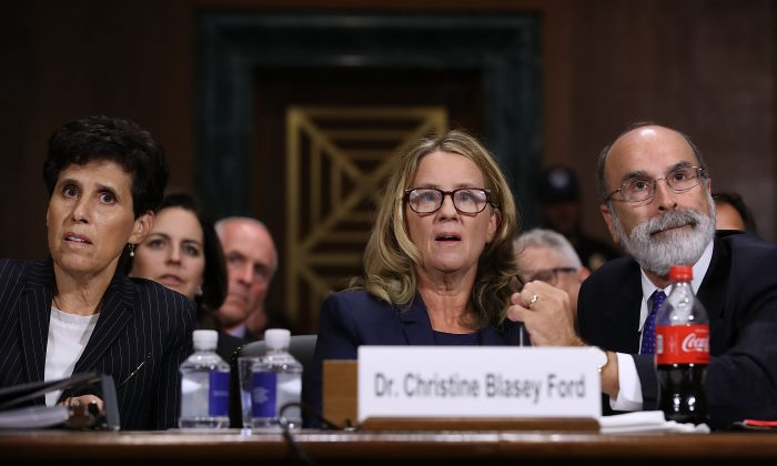 Christine Blasey Ford (C) is flanked by her attorneys Debra Katz (L) and Michael Bromwich as she testifies before the Senate Judiciary Committee in the Dirksen Senate Office Building on Capitol Hill, Washington, on Sept. 27, 2018. (Win McNamee/Getty Images)