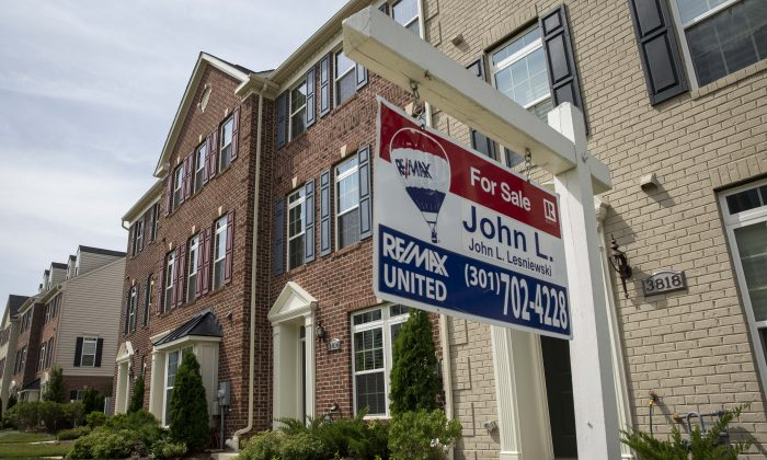 "A ""For Sale"" sign sits in the front yard of a townhouse Jun. 23, 2015 in Northeast Washington, DC. (Drew Angerer/Getty Images)"