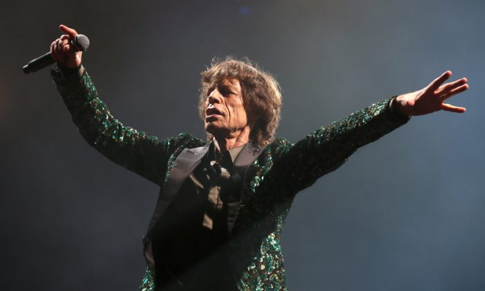 Sir Mick Jagger of The Rolling Stones performs on the Pyramid Stage at Glastonbury Festival 2013 on Jun. 29, 2013 in Glastonbury, England. (Matt Cardy/Getty Images)