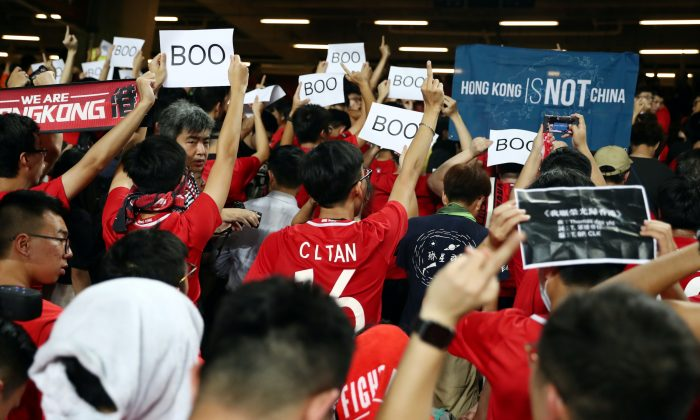 Soccer fans demonstrate inside Hong Kong Stadium in support of anti-government protesters as Hong Kong takes on Iran in World Cup qualifiers, in Hong Kong, China on Sept. 10, 2019. (Athit Perawongmetha/Reuters)