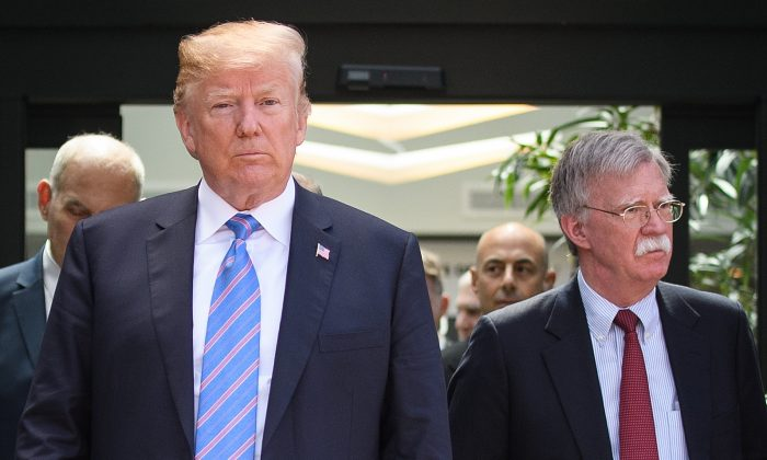 President Donald Trump (C) leaves with National Security Adviser John Bolton (R) after holding a press conference ahead of his early departure from the G-7 Summit in La Malbaie, Canada, on June 9, 2018. (Leon Neal/Getty Images)
