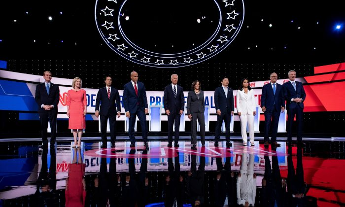 Democratic presidential hopefuls (L-R) US Senator from Colorado Michael Bennet, US Senator from New York Kirsten Gillibrand, former US Secretary of Housing and Urban Development Julian Castro, US Senator from New Jersey Cory Booker, former Vice President Joe Biden, US Senator from California Kamala Harris, US entrepreneur Andrew Yang, US Representative for Hawaii's 2nd congressional district Tulsi Gabbard, Governor of Washington Jay Inslee and Mayor of New York City Bill de Blasio arrive on stage ahead of the second round of the second Democratic primary debate of the 2020 presidential campaign season hosted by CNN at the Fox Theatre in Detroit, Michigan on July 31, 2019.  BRENDAN SMIALOWSKI/AFP/Getty Images