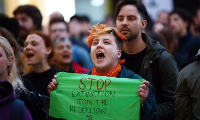 Protesters raise awareness for climate change at Melbourne Central, in Melbourne, Australia, on Sept. 6, 2019. (Graham Denholm/Getty Images)