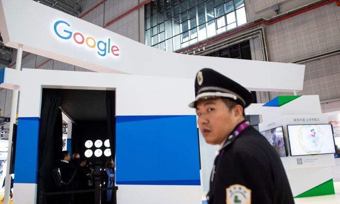A security guard passing a booth of Google at the first China International Import Expo in Shanghai on Nov. 5, 2018. (JOHANNES EISELE/AFP/Getty Images)