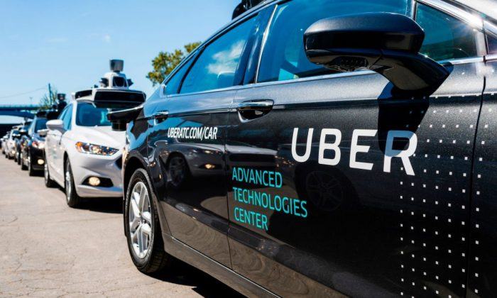 Uber services. (ANGELO MERENDINO/AFP/Getty Images)