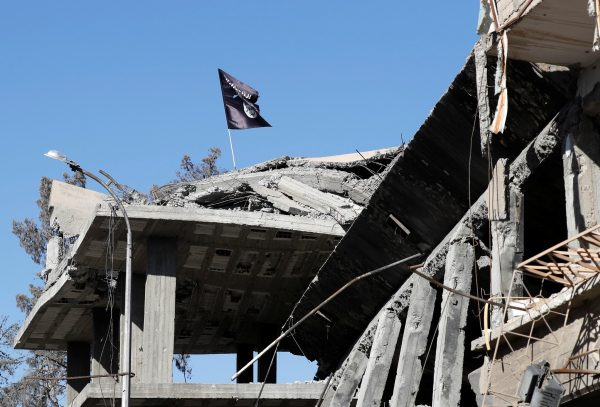 ISIS flag on destroyed building
