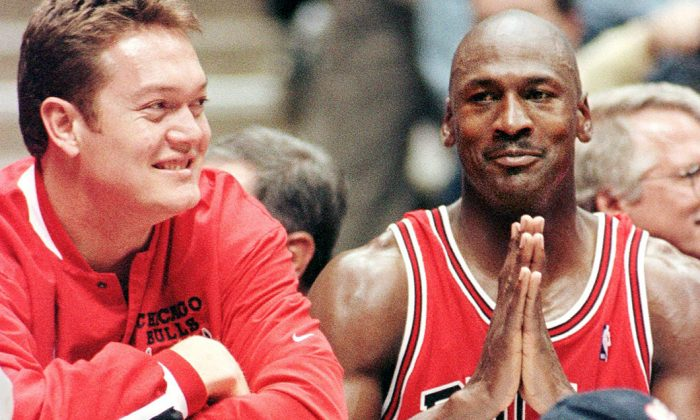 Michael Jordan (R) with Luc Longley when they played for the Chicago Bulls in East Rutherford, N.J., on April 29, 1998. (Stan Honda/AFP/Getty Images)